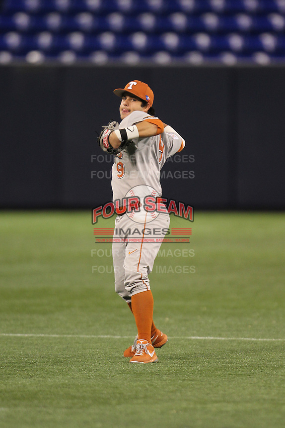 Texas Longhorns shortstop C.J. Hinojosa #9 throws during a game against the Minnesota Golden Gophers at the Metrodome on March 22, 2013 in Minneapolis, Minnesota. (Brace Hemmelgarn/Four Seam Images)