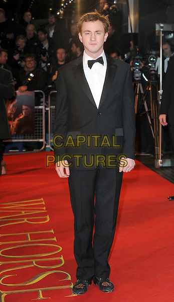 Francis Boulle from Made In Chelsea .The 'War Horse' UK film premiere, Odeon Leicester Square cinema, London, England..January 8th, 2012.full length white shirt bow tie tuxedo black.CAP/BEL.©Tom Belcher/Capital Pictures.