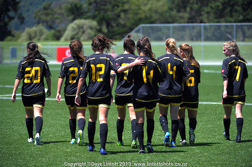 The Capital team walk out for the second half during the ASB Women's League football semifinal match between Capital (black with yellow trim) and Mainland (red and black) at Petone Memorial Park, Wellington, New Zealand on Sunday, 1 December 2013. Photo: Dave Lintott / lintottphoto.co.nz