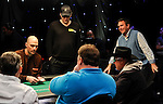 Phil Hellmuth stands as he is all in against Hoyt Corkins, foreground right.  Hellmuth doubled up.