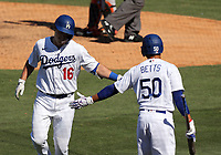 25th July 2020, Los Angeles, California, USA;  Los Angeles Dodgers catcher Will Smith (16) gets congratulated by Los Angeles Dodgers outfielder Mookie Betts (50) after Smith hit a home run during the game against the San Francisco Giants on July 25, 2020, at Dodger Stadium in Los Angeles, CA.