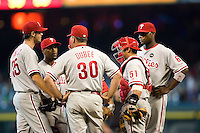 Phillies mound meeting 5790.jpg Philadelphia Phillies at Houston Astros. Major League Baseball. September 6th, 2009 at Minute Maid Park in Houston, Texas. Photo by Andrew Woolley.