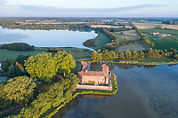 France, Ain, La Dombes region, Bouligneux, the castle at the edge of the Castle pond (aerial view) // France, Ain (01), la Dombes, Bouligneux, le château au bord de l'étang du Château (vue aérienne)