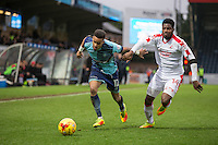 Paris Cowan-Hall of Wycombe Wanderers & Andre Blackman of Crawley Town during the Sky Bet League 2 match between Wycombe Wanderers and Crawley Town at Adams Park, High Wycombe, England on 25 February 2017. Photo by Andy Rowland / PRiME Media Images.