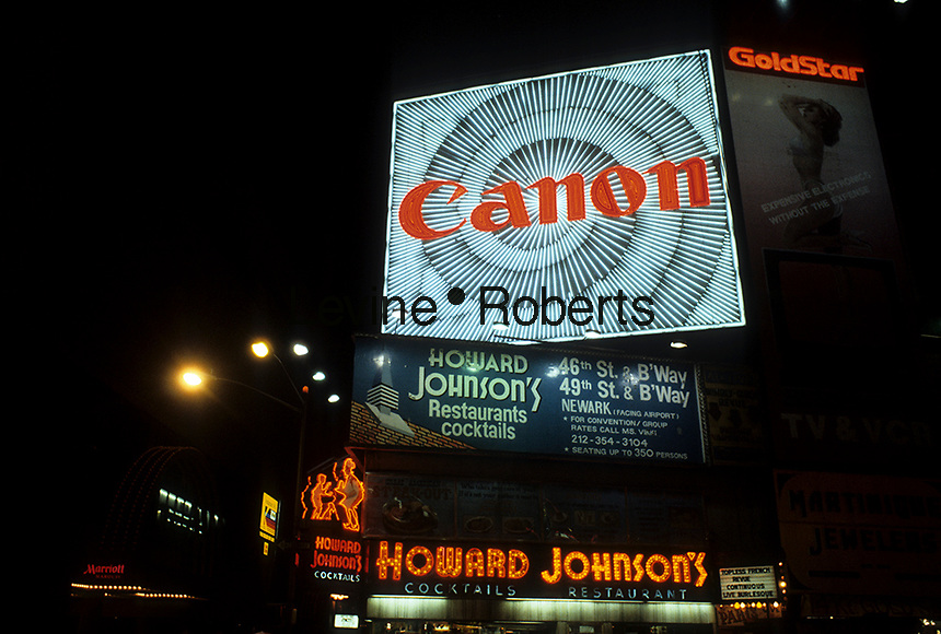 The Howard Johnson's Restaurant in Times Square in New York with an advertisement for Canon is seen in March 1987. The space is now the American Eagle Outfitters Times Sqaure flagship store, on the NW corner of West 46 and Broadway. ( © Richard B. Levine)