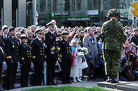 Royal Canadian Navy Officers including Lieutenant Commander Timothy O'Leary, of HMCS York, join together with Torontonians for the Rememberance Day ceremony in Toronto, Ontario, Canada, November 11, 2011.