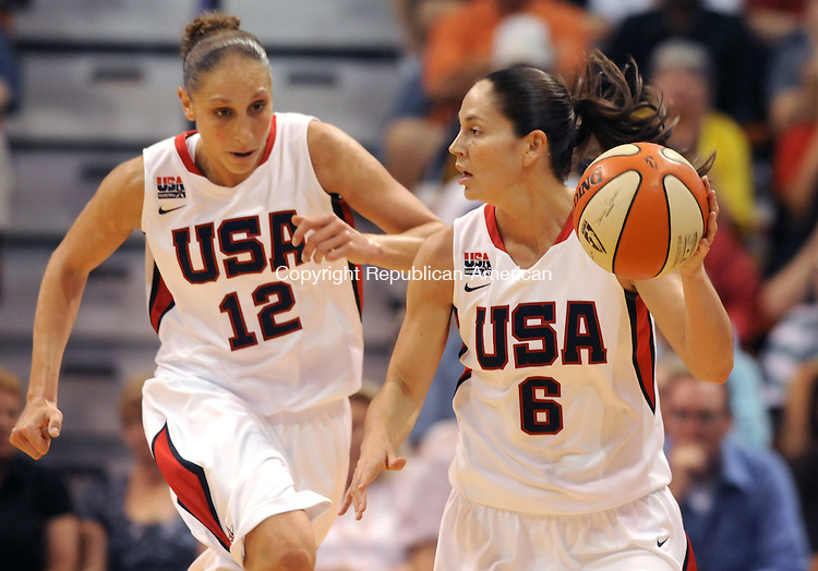 UNCASVILLE, CT 10  JULY, 2010-071010JS06-Team USA's Sue Bird (6) runs the ball up court with teammate Diana Taurasi (12) during their game against the WNBA All-Stars Saturday at the Mohegan Sun Arena in Uncasville. <br /> Jim Shannon Republican-American