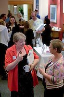 Teachers chat at a Teaching Expertise conference in Birmingham..