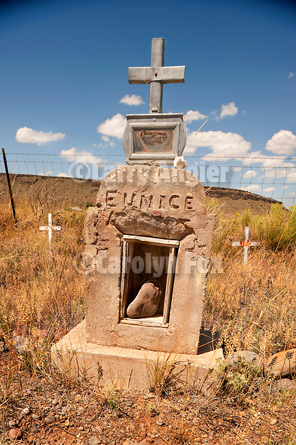 Cemetery and headstones behind the burned walls of San Ysidro Church in Las Mesitas. Colorado.