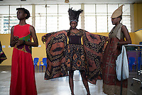 KINSHASA, DRC - JULY 22: Models fit collections by the designer 6KASSO days before Kinshasa Fashion Week on July 22, 2015, at Shark club in Kinshasa, DRC. Local and invited foreign-based designers showed their collections during the yearly Kinshasa Fashion week. (Photo by Per-Anders Pettersson)