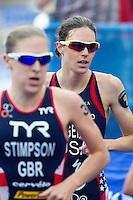 12 JUL 2014 - HAMBURG, GER - Gwen Jorgensen (USA) (right) from the USA begins her final run lap at the elite women's 2014 ITU World Triathlon Series round in the Altstadt Quarter, Hamburg, Germany  (PHOTO COPYRIGHT © 2014 NIGEL FARROW, ALL RIGHTS RESERVED)