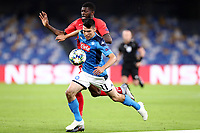 Jerome Onguene of FC Salzburg  and Hirving Lozano of Napoli compete for the ball<br /> Napoli 05-11-2019 Stadio San Paolo <br /> Football Champions League 2019/2020 Group E<br /> SSC Napoli - FC Salzburg<br /> Photo Cesare Purini / Insidefoto