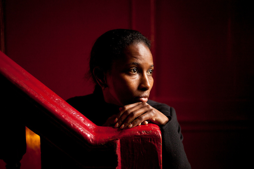 Aayan Hirsi Ali, photographed in the Union Club in Soho. Ali is known as a fierce critic of Islam and the way it treats women. Ali has been subjected to death threats due to her divisive opinions on Islam. Ayaan Hirsi Ali is a Dutch feminist activist, writer, politician and founder of the women's rights organisation, the AHA Foundation. She is the daughter of the Somali scholar, politician, and revolutionary opposition leader Hirsi Magan Isse. She is a prominent critic of Islam, and her screenplay for Theo van Gogh's movie Submission led to death threats. When she was eight, Hirsi Ali's family left Somalia for Saudi Arabia, then Ethiopia, and eventually settled in Kenya. She sought and obtained political asylum in the Netherlands in 1992, under circumstances that later became the center of a political controversy. In 2003 she was elected a member of the House of Representatives (the lower house of the Dutch parliament), representing the People's Party for Freedom and Democracy (VVD). A political crisis surrounding the potential stripping of her Dutch citizenship led to her resignation from the parliament, and led indirectly to the fall of the second Balkenende cabinet in 2006..As of 2011, Hirsi Ali is a fellow at the American Enterprise Institute, a conservative think tank, and has been living in the United States. In 2005, she was named by Time magazine as one of the 100 most influential people in the world. She has also received several awards including a free speech award from the Danish newspaper Jyllands-Posten, the Swedish Liberal Party's Democracy Prize,and the Moral Courage Award for commitment to conflict resolution, ethics, and world citizenship. In 2006 she published her memoir, which appeared in English translation in 2007 titled Infidel.
