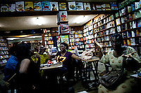 friends of the family who own the Jazz hole, a prominent record store, enjoy each other's company in the cafe dpt of the store in Nigeria's capital Lagos on Saturday March 28 2009..