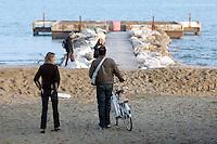 Passeggiata in bicicletta sulla spiaggia del Lido di Venezia.<br /> Cyclists on the beach at Venice's Lido.<br /> UPDATE IMAGES PRESS/Riccardo De Luca