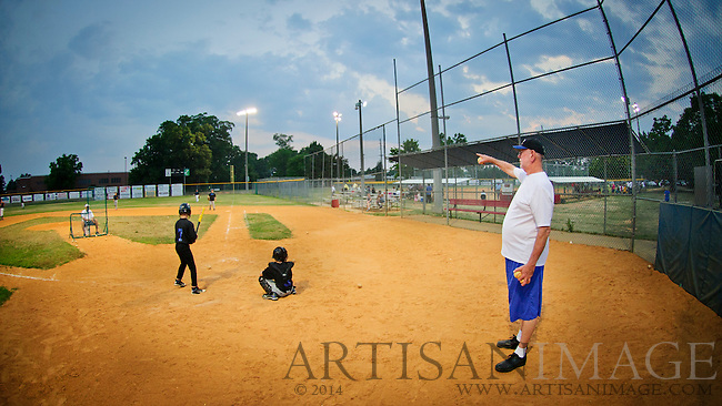"""Iverson """"Smitty"""" Smith coaches his team the Royals at Honeycutt Kiwanis Recreation Center in Fayetteville, NC on Wednesday June 8, 2011.  Smitty is wrapping up his 42 season as a baseball coach.  (Artisan Photography by Chris English)"""