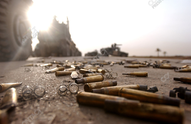 For the attention of foreign pix-For story by Dexter Filkins-Spent cartridges littered Highway 6, the road to Baghdad, next to a captured Iraqi position as US Marines waited to make their final push towards the Iraqi captial. April 4, 2003