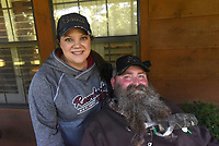 NWA Democrat-Gazette/FLIP PUTTHOFF <br /> Jackie and Steve Swope are a deer hunting team. Jackie is her husband's hunting companion in the woods. She helps him get situated in the blind and get his crossbow ready to shoot. Steve bags a doe most years, but he's excited about the 8-point buck he shot this year.