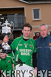 Mid Kerry board  Chairman Michael Sayers presents Milltown/Castlemaine captain Mike Burke the Michael O'Connor Memorial cup after they defeated Keel in the Mid Kerry final in Killorglin on Sunday