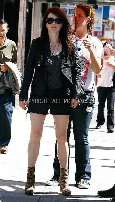 WWW.ACEPIXS.COM . . . . .  ....September 9 2011, New york City....Actress Julianne Moore on the set of the new movie 'What Maisie Knew' on September 9 2011 in New ....Please byline: CURTIS MEANS - ACE PICTURES.... *** ***..Ace Pictures, Inc:  ..Philip Vaughan (212) 243-8787 or (646) 679 0430..e-mail: info@acepixs.com..web: http://www.acepixs.com