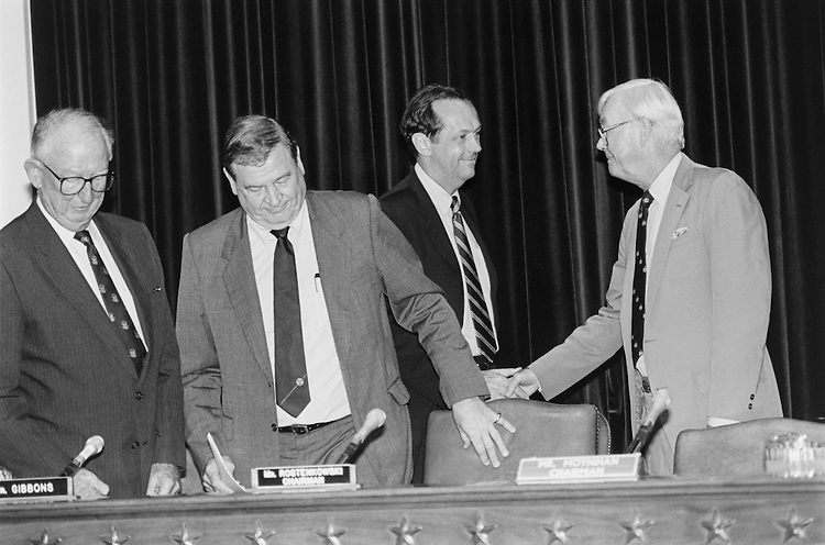 "Rep. Daniel David ""Dan"" Rostenkowski, D-Ill., Chairman of the Ways and Means Committee, Rep. James Arthur ""Jim"" Gibbons, R-Nev., Sen. William Warren ""Bill"" Bradley, D-N.J., and Sen. Daniel Patrick ""Pat"" Moynihan, D-N.Y., shake hands before a budget reconciliation meeting. July 20, 1993 (Photo by Maureen Keating/CQ Roll Call)"