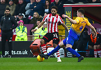 Lincoln City's Bruno Andrade vies for possession with  Mansfield Town's Matt Preston<br /> <br /> Photographer Andrew Vaughan/CameraSport<br /> <br /> The EFL Sky Bet League Two - Lincoln City v Mansfield Town - Saturday 24th November 2018 - Sincil Bank - Lincoln<br /> <br /> World Copyright &copy; 2018 CameraSport. All rights reserved. 43 Linden Ave. Countesthorpe. Leicester. England. LE8 5PG - Tel: +44 (0) 116 277 4147 - admin@camerasport.com - www.camerasport.com