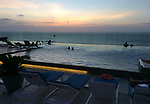 Colombia, Cartagena de Indias -- July 21, 2017 -- Bocagrande, modern part of town with high-standard hotels, apartment buildings and popular beaches; here, sunset seen from infinity pool at the 11th floor of a luxury hotel -- architecture, tourism -- Photo © HorstWagner.eu