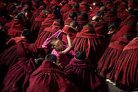 Young Tibetan Buddhist monks of the Gelugpa order (Yellow Hat Sect) gather for a ceremony at the Labrang Monastery in Xiahe, Gansu Province, China.  The Labrang Monastery (also known as Labuleng Si) is one of the most important Tibetan monasteries outside of the current borders of Tibet.