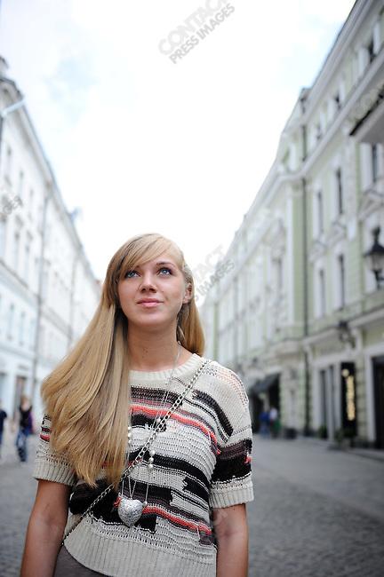 Olga Chikina, 23, psychologist, photographed on Stoleshnikov Pereyulok, Moscow, Russia, July 12, 2009
