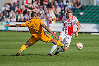 Danny Wright of Cheltenham gets past Jamie Turley of Newport County during the Sky Bet League 2 match between Newport County and Cheltenham Town at Rodney Parade, Newport, Wales on 10 September 2016. Photo by Mark  Hawkins / PRiME Media Images.