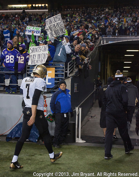 Seattle Seahawks  fans hold signs and heckle New Orleans Saints players as they depart the field at CenturyLink Field in Seattle, Washington on December 2, 2013. The Seahawks became the first team to clinch a spot in the NFC playoffs with a 34-7 victory over the New Orleans Saints.  The Seahawks beat the Saints 34-7 to take the best record team in the NFL.©2013. Jim Bryant Photo. ALL RIGHTS RESERVED.