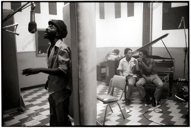 Jack Ruby (bearded, center) and musicians during the season.  Kingston, Jamaica. March 1976