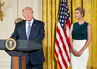 United States President Donald J. Trump makes remarks at an event with small businesses in the East Room of the White House in Washington, DC on Tuesday, August 1, 2017.  Looking on from the right is Ivanka Trump. Photo Credit: Ron Sachs/CNP/AdMedia