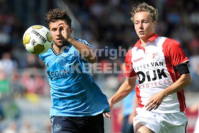 EMMEN - FC Emmen - Ajax voorbereiding  seizoen 2011-2012 , 09-07-2011 Emmen speler Joorit Kunst (r) met Ajax speler Miralem Sulejmani.