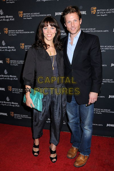 KERRY NORTON & JAMIE BAMBER .17th Annual BAFTA Los Angeles Awards Season Tea Party held at the Four Seasons Hotel, Beverly Hills, California, USA, 15th January 2011..full length jeans trousers navy green clutch bag   blue shirt smiling .CAP/ADM/BP.©Byron Purvis/AdMedia/Capital Pictures.