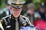 Las Vegas Metro Sheriff Douglas Gillespie pauses at the memorial wreath during the annual Law Enforcement Officers Memorial ceremony on Thursday, May 1, 2014, in Carson City, Nev. Metro Officer David Vanbuskirk was recognized after he died in the line of duty in 2013. (Las Vegas Review-Journal/Cathleen Allison)