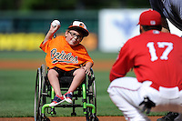 Five-year-old Cade Coleman, who attends Greenview Child Development center, throws out the ceremonial first pitch before a game between the Lexington Legends and the Greenville Drive on Sunday, April 27, 2014, at Fluor Field at the West End in Greenville, South Carolina. Greenville won, 21-6. (Tom Priddy/Four Seam Images)