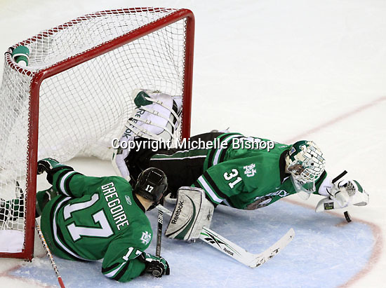 North Dakota goalie Brad Eidsness pounces on a loose puck during the second period. Looking on is Jason Gregoire. No. 8 North Dakota used a three-goal third period to beat No. 4 UNO 6-5 Friday night at Qwest Center Omaha. (Photo by Michelle Bishop)