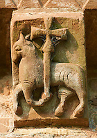 Norman Romanesque exterior corbel no 39  -  sculpture of.an Angus Dei, the symbol of Jesus Christ as the Lamb of God. Strangely the creature holding the cross is a horse not a sheep. The sculpture is place in the centre of the Eastern Apse, symbolically the most important part of the church. The Norman Romanesque Church of St Mary and St David, Kilpeck Herefordshire, England. Built around 1140