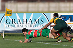 Nathan Millar dives over to score for Waiuku. Counties Manukau Premier Club rugby game between Pukekohe and Waiuku, played at Colin Lawrie Fields, Pukekohe on Saturday April 14th, 2018. Pukekohe won the game 35 - 19 after leading 9 - 7 at halftime.<br /> Pukekohe Mitre 10 Mega -Joshua Baverstock, Sione Fifita 3 tries, Cody White 3 conversions, Cody White 3 penalties.<br /> Waiuku Brian James Contracting - Lemeki Tulele, Nathan Millar, Tevta Halafihi tries,  Christian Walker 2 conversions.<br /> Photo by Richard Spranger