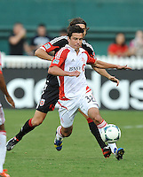 Andrew Wiedeman (32) of Toronto FC shields the ball against Dejan Jakovic (5) of D.C. United. Toronto FC tied D.C. United 1-1, at RFK Stadium, Saturday August 24 , 2013.