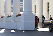 United States President Barack Obama walks out of the North Portico of the White House on his way to play basketball in Washington DC April 14, 2013.   .Credit: Molly Riley / Pool via CNP