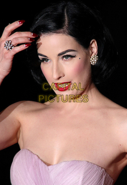 DITA VON TEESE .British Comedy Awards at the London ITV Studios, South Bank, London, England, December 6th 2008..portrait headshot strapless red lipstick make-up blusher eyeliner cleavage bare shoulders pearl earrings beauty spot mark hand touching head ring nails nail varnish .CAP/JIL.©Jill Mayhew/Capital Pictures