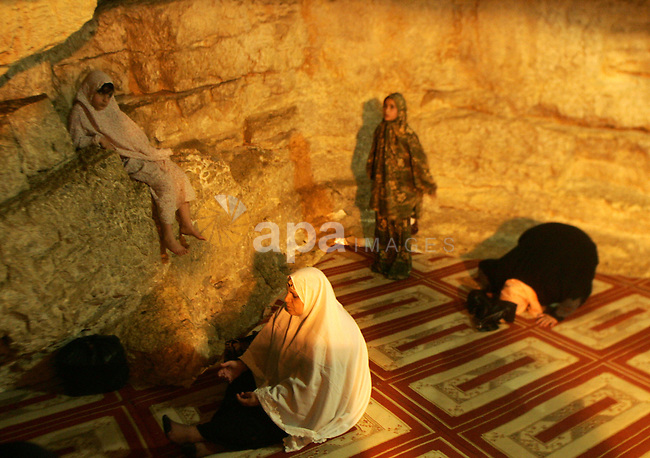 Palestinian Muslim worshippers pray inside the Dome of the Rock at the Al-Aqsa Mosques compound in Jerusalem's Old City on Jun 23, 2011. Photo by Mahfouz Abu Turk