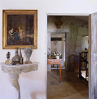 A glimpse onto the first floor landing past an antique console table