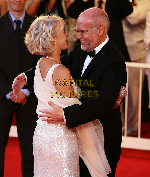 "HELEN MIRREN & MARCO MULLER.""The Queen"" premiere screening at the 63rd Venice International Film Festival, Venice, Italy. .September 2nd, 2006 .Ref: OME/GPA.half length white sequins silver dress wrap sheer hug embrace suit jacket.www.capitalpictures.com .sales@capitalpictures.com .©Omega/Capital Pictures"