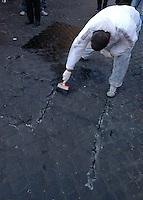 Giovani studenti del liceo Cavour cancellano dai muri scritte naziste e fasciste, insieme agli operatori del decoro urbano dell'Ama..Young high school students erase Nazi and fascist written from walls,.along with the operators of urban decorum of Ama..
