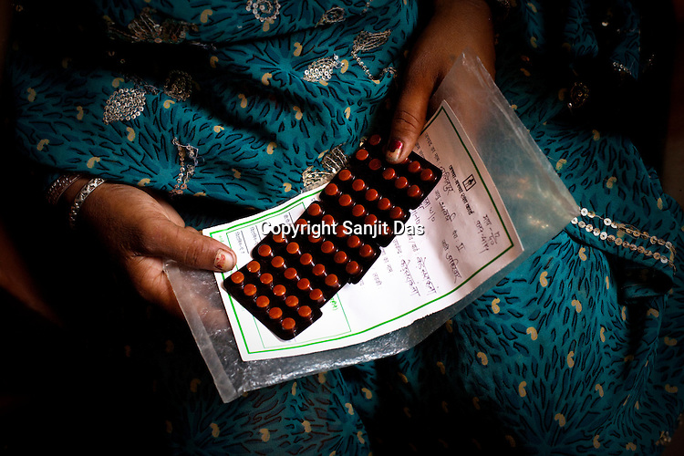 Young mothers are given iron folic acid tablets at the Anganwadi centre in Kalesra Kala village in Lalitpur district of Uttar Pradesh, India. The Indian government spends $1.4 billion a year - on programs that include weighing newborn babies, counseling mothers on healthy eating and supplementing meals, but none of this is yeilding results. According to UNICEF, some 48% of Indian children, or 61 million kids, remain malnourished, the clinical condition of being so undernourished that their physical and mental growth are stunted. Photo: Sanjit Das/Panos for The Wall Street Journal.Slug: IMALNUT