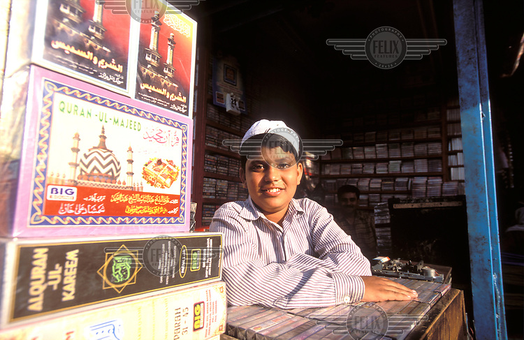 © Chris Stowers / Panos Pictures..Old Delhi, INDIA..Muslim boy selling religious artefacts.