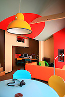 The apartment has a theatrical and flamboyant air mainly due to the vibrant colour scheme